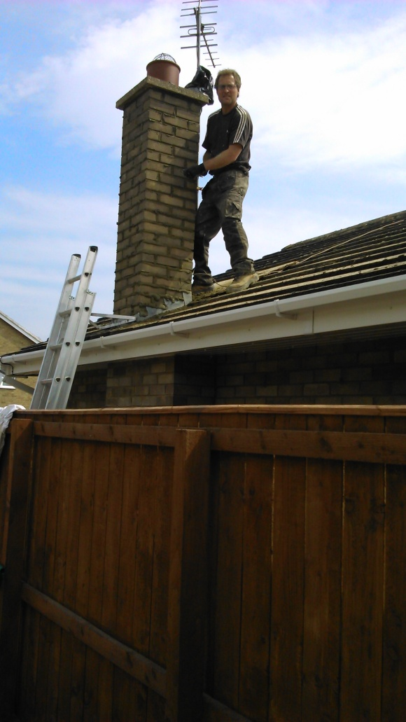 Repointing a chimney at Doug's bungalow