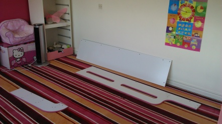 Starting the assembly flat pack of a child's bed with units.