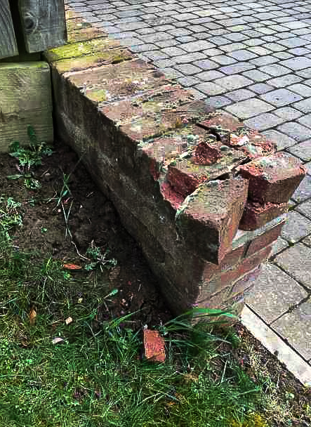 Damaged bricks on wall
